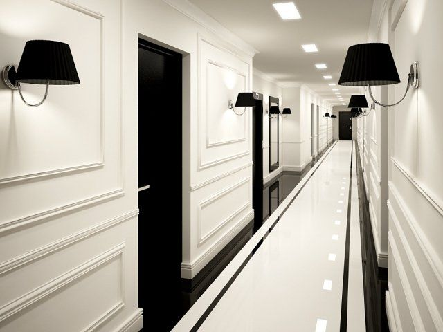 Beautiful mouldings, sconces, striking use of black and white