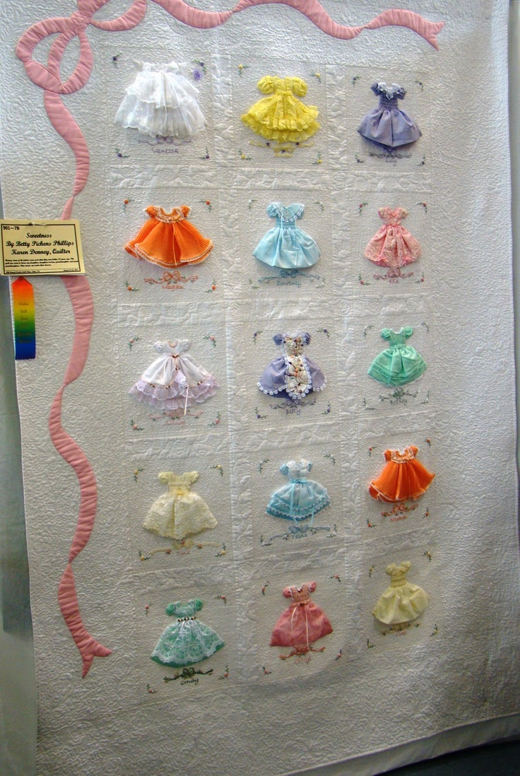 Tiny dresses quilt. I can't find the actual place this came from, but it is awesome!