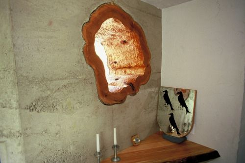 Window made from stump, embedded in a rammed earth wall