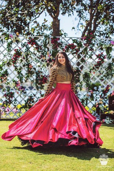 Light Lehengas - Pink Silk Flowy Lehenga with a Full Sleeve Gold and Black Blouse | WedMeGood #wedmegood #indianbride #indianwedding #bridal #lehenga #lightlehenga #pink #fullsleeve