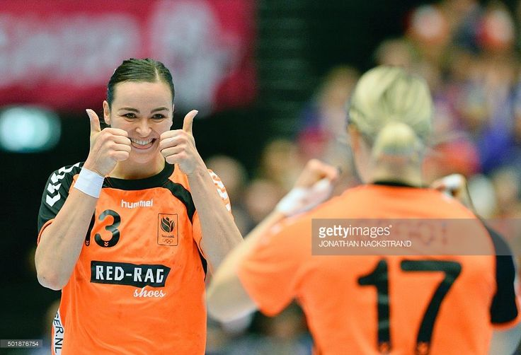 Netherlands Yvette Broch (L) celebrates with her teammate Cornelia Groot after scoring a goal during the 2015 Women's Handball World Championship semi-final match between the Netherlands and Poland in Herning, Denmark on December 18, 2015. / AFP / JONATHAN