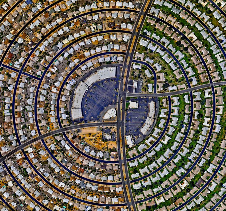"""Sun City, Arizona, USA, 33.6189504, -112.291099 // Houses, built in concentric circles, make up a section of Sun City, Arizona, USA. When the development opened on January 1, 1960, the event attracted a crowd of more than 100,000 onlookers and the """"futuristic development"""" was featured on the cover of Time magazine."""