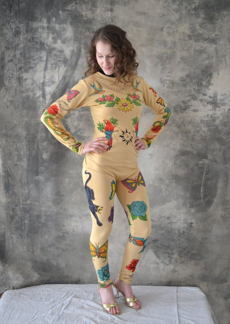 Unusual two piece tattooed body suit circa 1970s. Made from a soft stretchy spandex printed with all the tattoo classics including: sparrows,