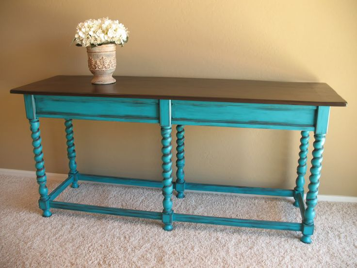 Love, love, love turquoise distressed furniture as an accent piece.