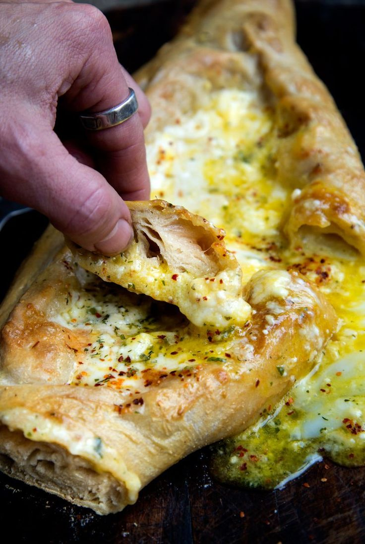 Adjaruli (Acharuli)Khachapuri is a traditional Georgian (the country, that is), canoe-shaped bread filled with a generous amount of cheese and topped with an egg. If you like cheese (and who doesn…