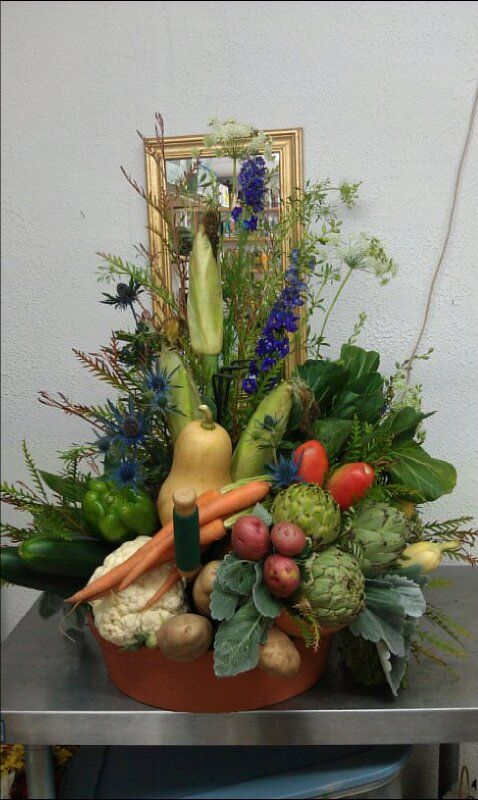 Vegetable garden arrangement I did for the funeral of an avid gardener