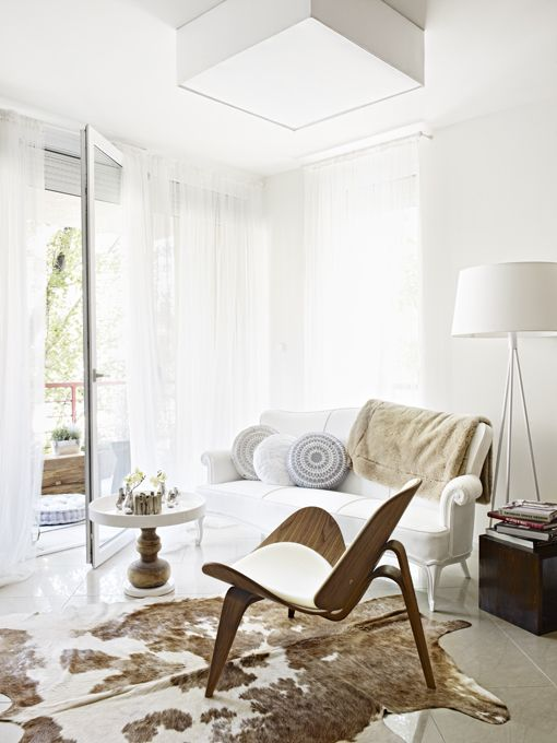 mix of furnishings, white space, cowhideInterior Design, Budapest Hungary, M2 Flats, Interiors Design, Living Room, Flats Renovation, Small Spaces Living, Viktor Csap, Apartments Interiors