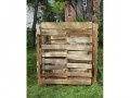 Fasten together three wooden pallets to make three sides of a box. Put the fourth side on hinges to create a door. Pallets are ideal for compost piles because their slatted structure allows air to flow into the pile