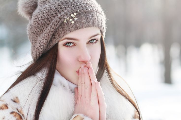 Outdoor portrait of young pretty beautiful woman in cold sunny winter weather in park. Sensual brunette posing and having fun