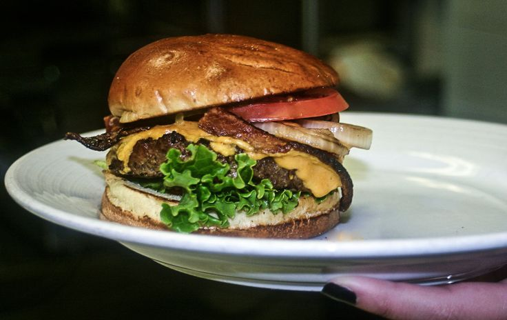 For all of the #burger lovers, stop in to #STATE today and try this classic pick for only $6.99. Our All #American burger is cooked to the temperature of your choice, and topped with lettuce, tomato, grilled onion, applewood smoked bacon, crispy pickle chips, melted merkt's cheddar cheese, ketchup & mustard. For $1 more, you can add a fried egg, too! #STATEChicago #LincolnPark #Foodies #TGIF #Restaurants #Bars #ThingsToDoInChicago