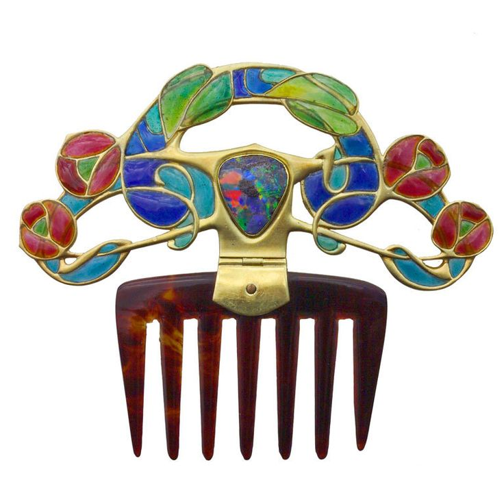 ARCHIBALD KNOX An Important Diadem Comb for Liberty & Co  Britain  circa 1900  An extremely beautiful unrecorded Diadem by Archibald Knox.  This is a metamorphic jewel being adjustable to both a diadem and a decorative comb.