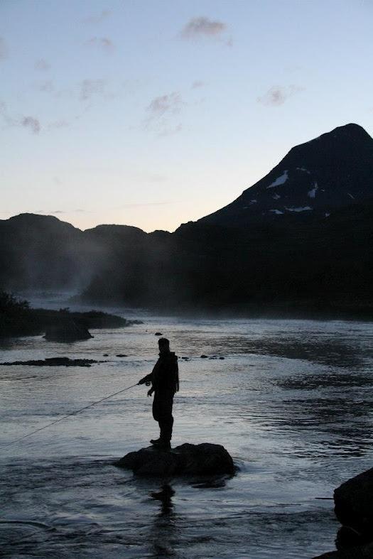 Man and fishing rod.