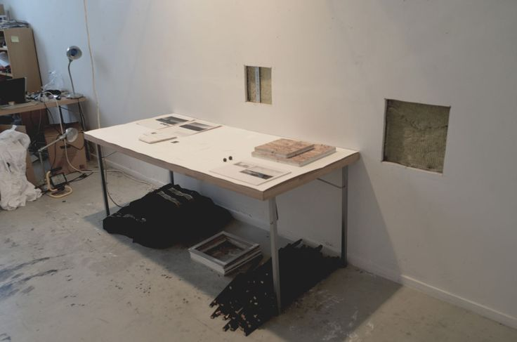 the Deconstruction Project, First Session >View of artifacts installation and pieces of wall cut out.