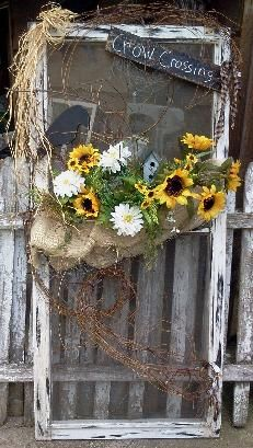 Old Window Screen...with a prim crow & sunflowers.