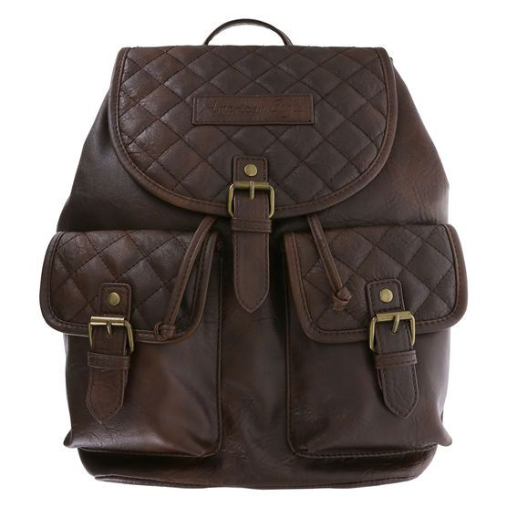 """This quality backpack from American Eagle features a tumbled outer with quilted accents and buckle details, two front pockets, magnetic snap and drawstring close, lined interior with two open side pockets and one zippered, hanging loop, and two adjustable shoulder straps, 14""""HX12""""WX7""""D. 100% Vinyl."""