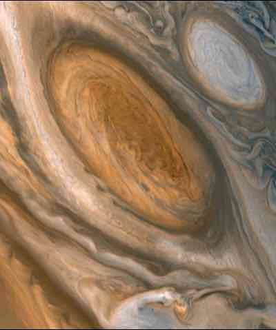 Jupiter: the Great Red Spot  Imagine a storm which could swallow 100,000 Hurricane Katrinas and has been raging not for days, but for centuries. Jupiter's Great Red Spot, which may have first been seen as early as 1655, boggles the imagination. The Red Spot's colour may come from chemicals like phosphorus which are dredged from belowPhotograph: © NASA / Planetary Visions