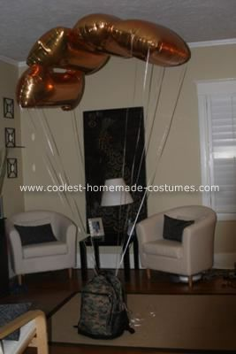 Homemade Paratrooper Costume: My son wanted to be a paratrooper with a parachute. I went online and ordered a military uniform. Then I went to the local party store and purchased (4) gold #1 balloons