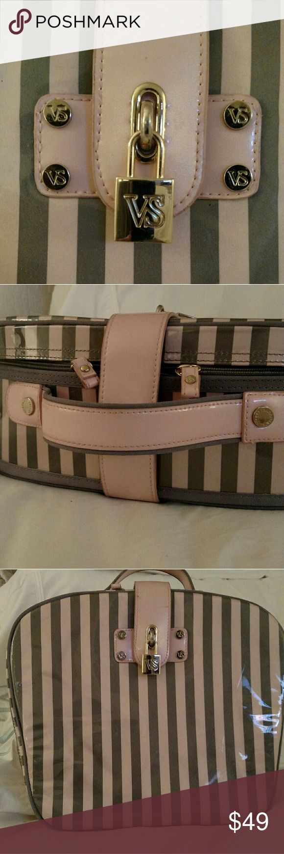 Victoria's Secret case Victoria's Secret train case!  Pink and Gray stripe, Gold lock...with handle...excellent shape...no rips or tears... interior has makeup stains...can be used as makeup case... Large sized... Very unique.... offers accepted Victoria's Secret Makeup