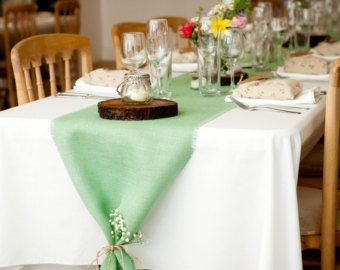 Seafoam table runner on top of a brown tablecloth.