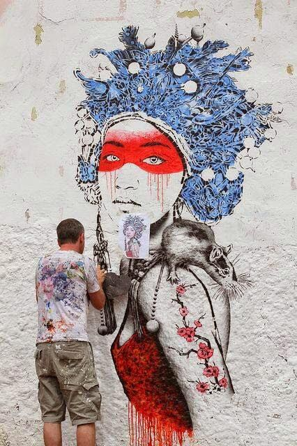 Finbarr DAC working on a wall at La Candelaria, Bogota (Colombia)