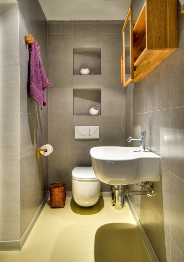Add built-in shelving to declutter your small bathroom space.