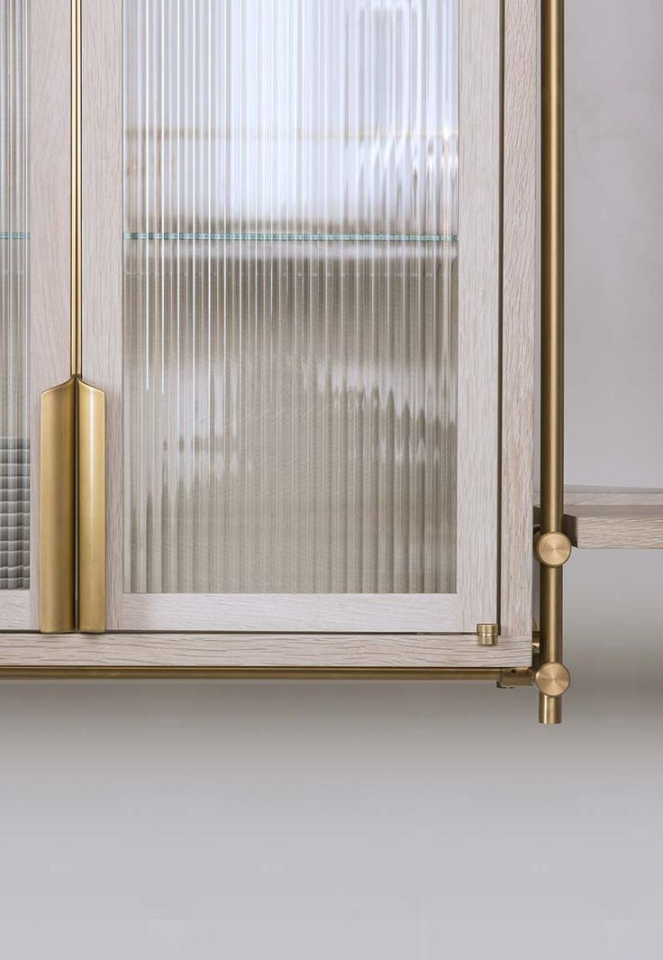 Amuneal Collector's Shelving   CSU #kitchen; exposed brass framework, bleached oak, ribbed glass