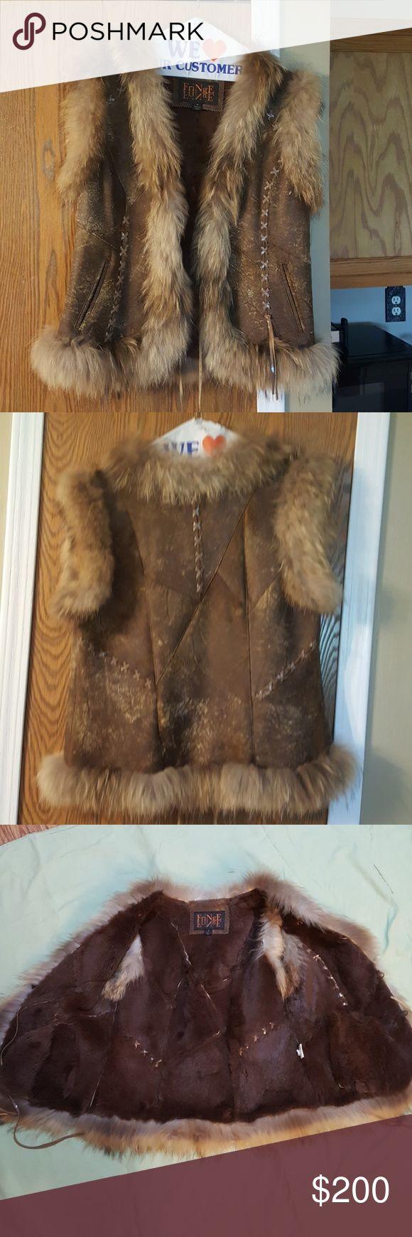 FriNge fur vest Racoon and rabbit fur vest, worn only once, bought in Las Vegas Jackets & Coats Vests