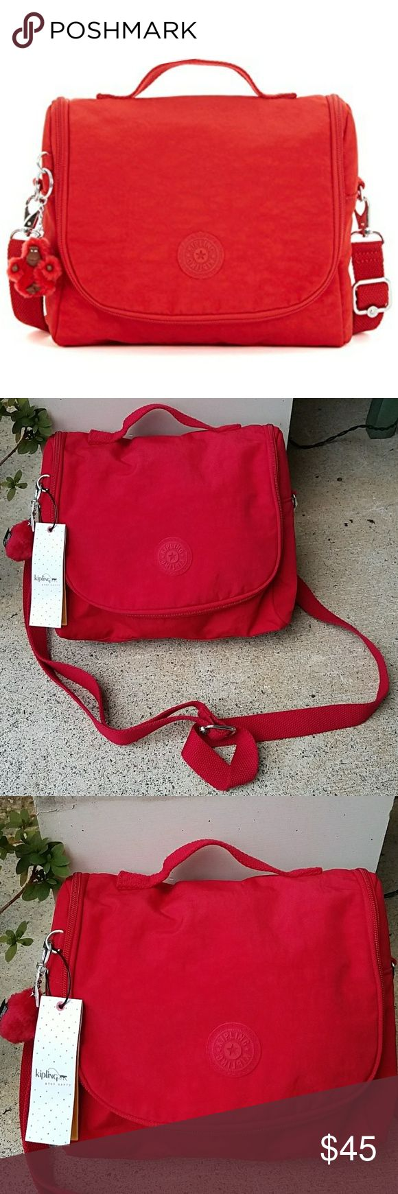 NWT!! Kipling Cherry Red Insulated Lunch Bag NWT!!  Back  Description  Kipling's reinvented lunch bag is tailored with an insulated interior, an adjustable strap, an interior net lining and added interior space that makes it perfect for carrying your lunch to school or work. Size: 9 x 8 x 4.75 inches, Weight: 0.6 lb Kipling Bags