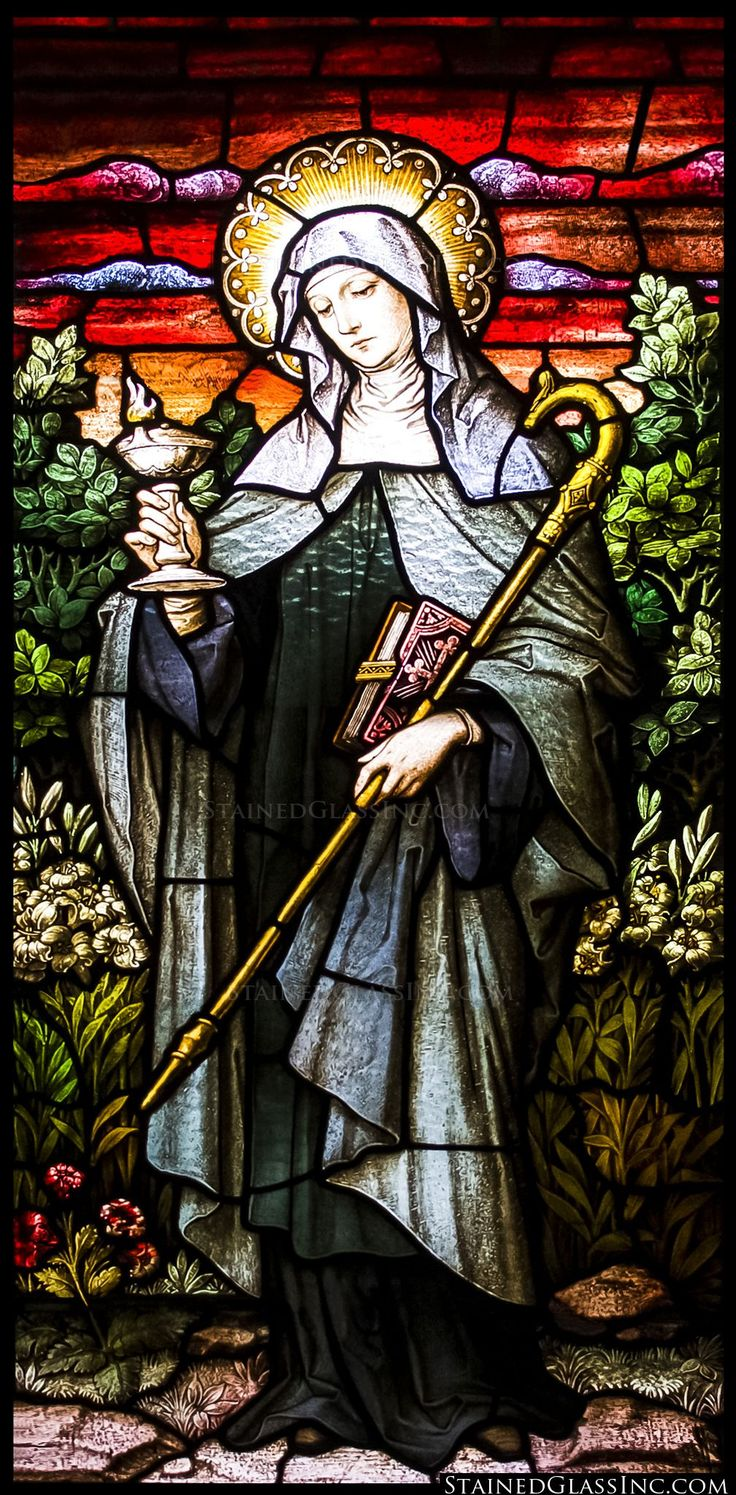 St. Brigid Stained Glass Window, the burning lamp represents compassion