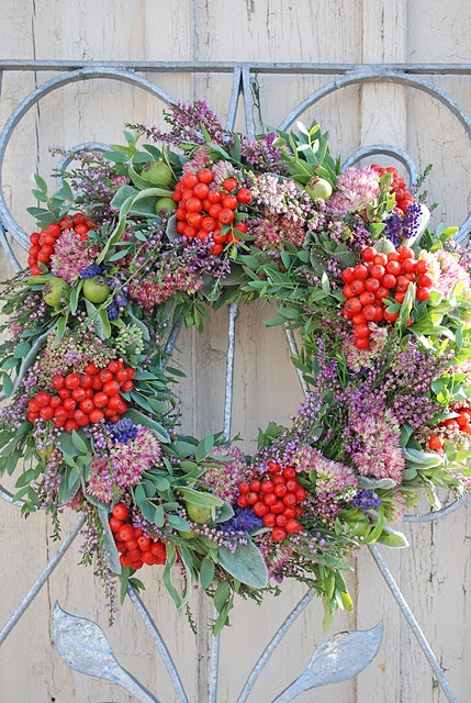 beautiful autumn wreath of berries, heather, lambs ear, lavender, orpine, poplar and small silver pear. nice love the colors
