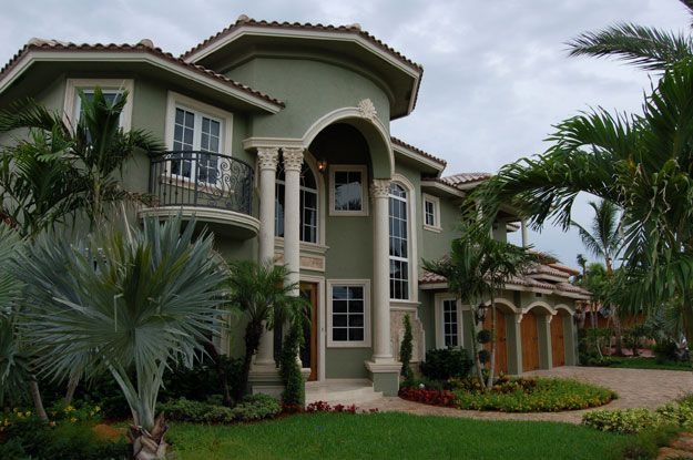 Large two story spaces in this design add elegance to this for Large mediterranean house plans