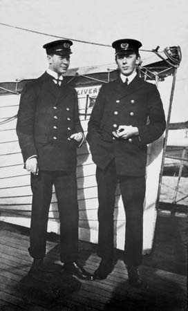 """Two Marconi operators photographed aboard the """"Adriatic"""" sometime before the """"Titanic"""" voyage. The man on the left is Jack Phillips, the heroic sender of the distress signals who stuck to his post and went down with the Titanic."""