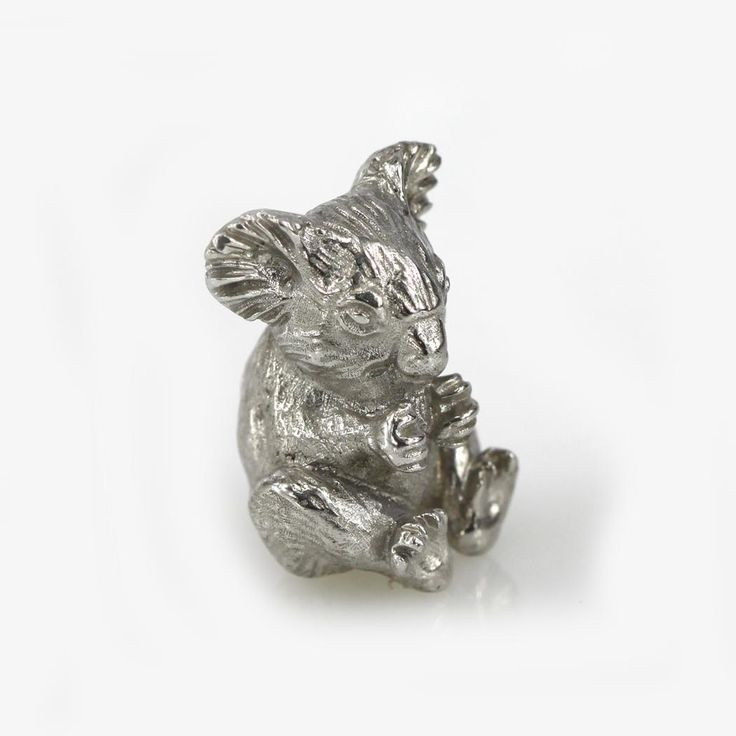 A beautifully detailed koala bear sitting made of solid sterling silver.