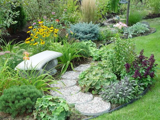 pretty garden bench with path and flower beds