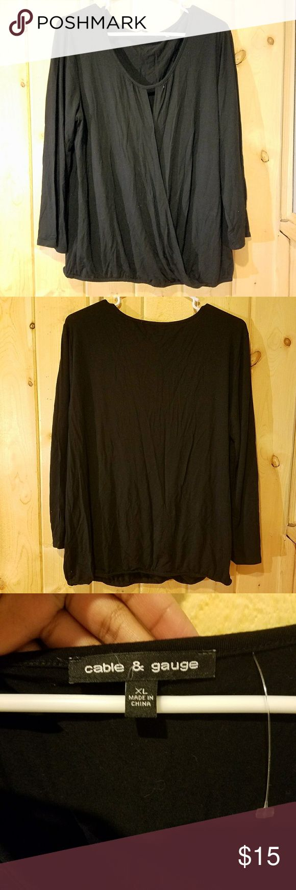 NWOT Black Surplice Top NWOT Black Surplice Top  Size XL 95% Viscose 5% Spandex Loose fit Cinched at the waist Pair this surplice top with some light wash skinny jeans or shorts for a casual outfit.  Make an offer! Tops Blouses