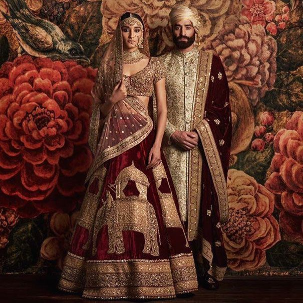Indian Wedding - In Indian culture, pink or red wedding dresses are often the garment of choice for brides. Married woman in the north of the country can often be identified by a red dot in the middle of their forehead.