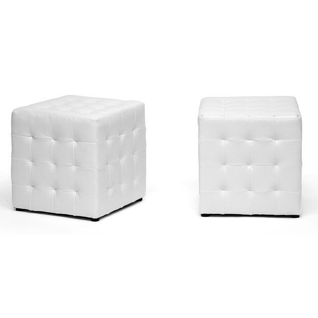 These modern cube ottomans by Siskal feature a lovely faux leather upholstery with a stylish tufted appearance. The ottomans thoughtfully arrive in a set of two to complete the fashionable look of your living space.