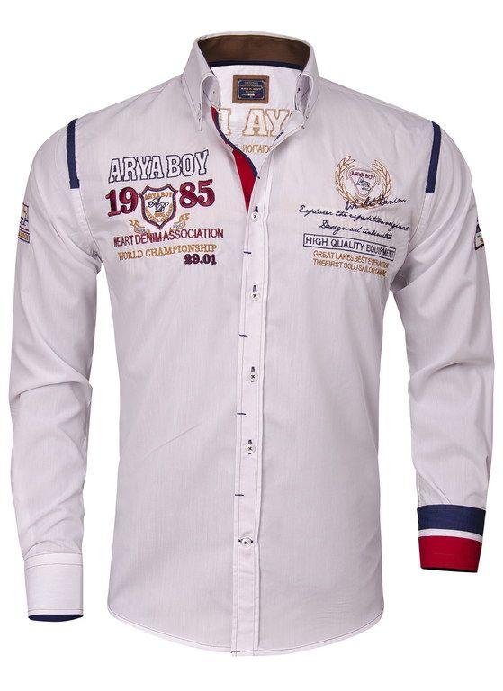 Wit heren overhemd met borduur van Arya Boy. Het slimfit overhemd is gemaakt van 80% katoen en 20% polyester. Op het overhemd is een borduur Arya Boy 1985. Dit shirt met transparante witteknopen is afgewerkt met een normale sluiting, een verstevigd manchet en een stevige kraag.