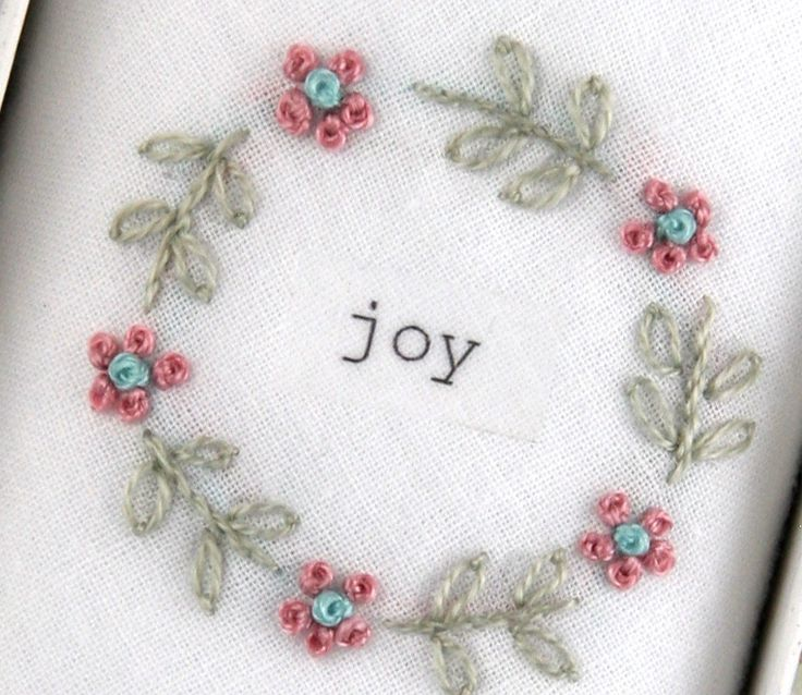 A delicately embroidered woman's hankie. A wonderful way to wish 'Joy' for a lady!