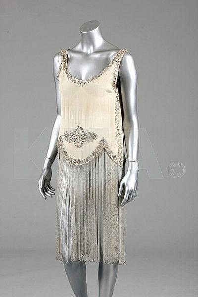 A Paul Poiret beaded ivory silk crepe de chine cocktail dress, circa 1927, Kerry Taylor Auctions
