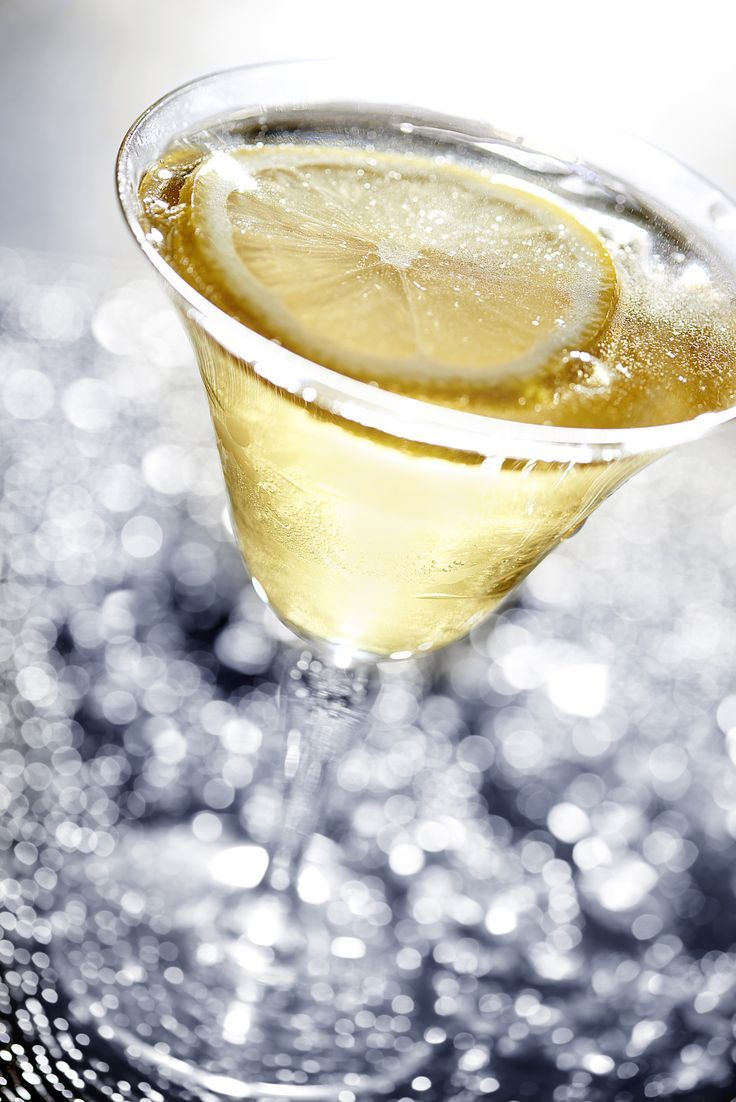 Ever tried a twist or slice of lemon in your champagne or prosecco? Delicious! ~~  Houston Foodlovers Book Club