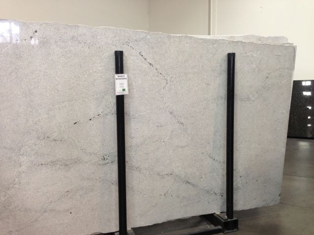 Bianca Montana:  This granite is the lightest, least busy granite i've seen. It isn't by any means a white, definitely more an off white/light cream color. But the grey is nice, and as always, granite is beautifully durable and easy to work with.