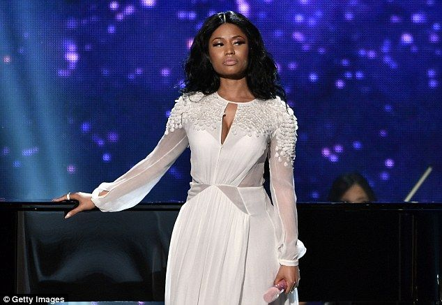 'He's a little angel': Nicki Minaj raps about losing a child at the age of 16, and was onc...