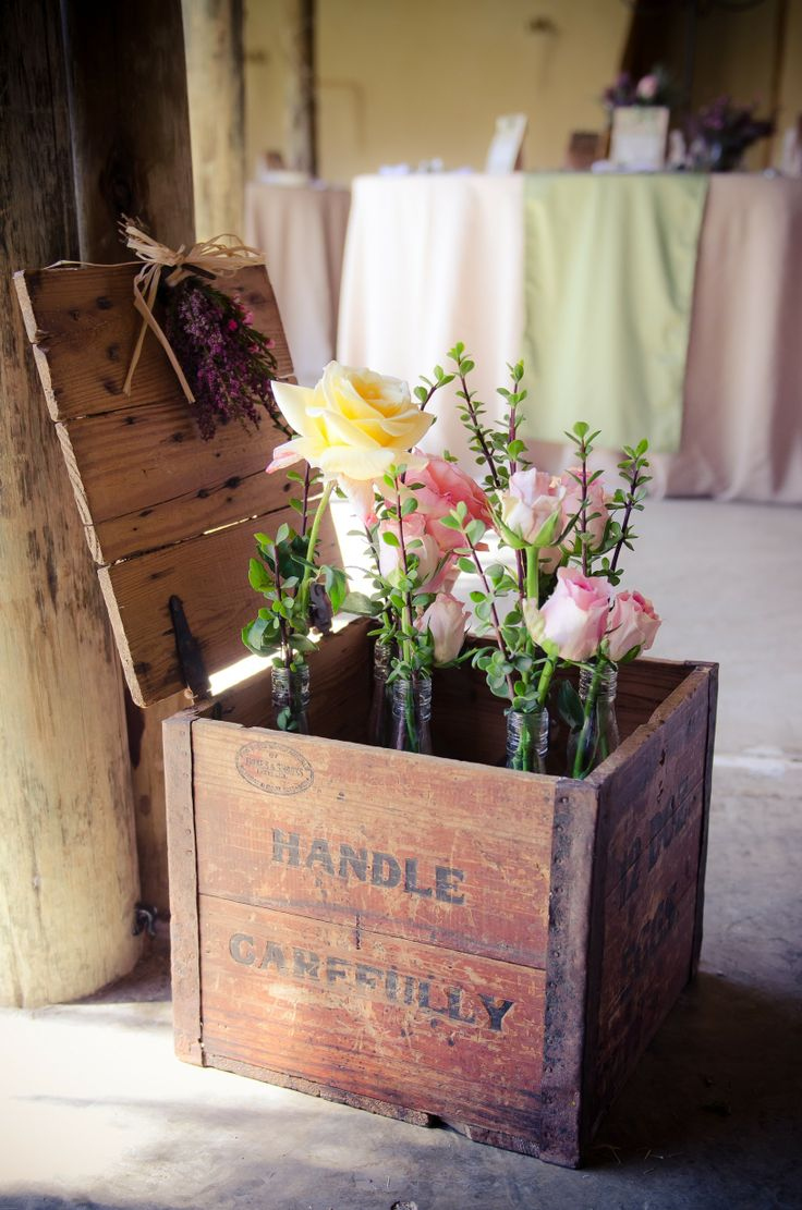 Beautiful antique egg boxes filled with roses and indigenous spekboom