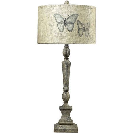 Table lamp with a butterfly drum shade and distressed silver finish.Product: Table lamp    Construction Material: