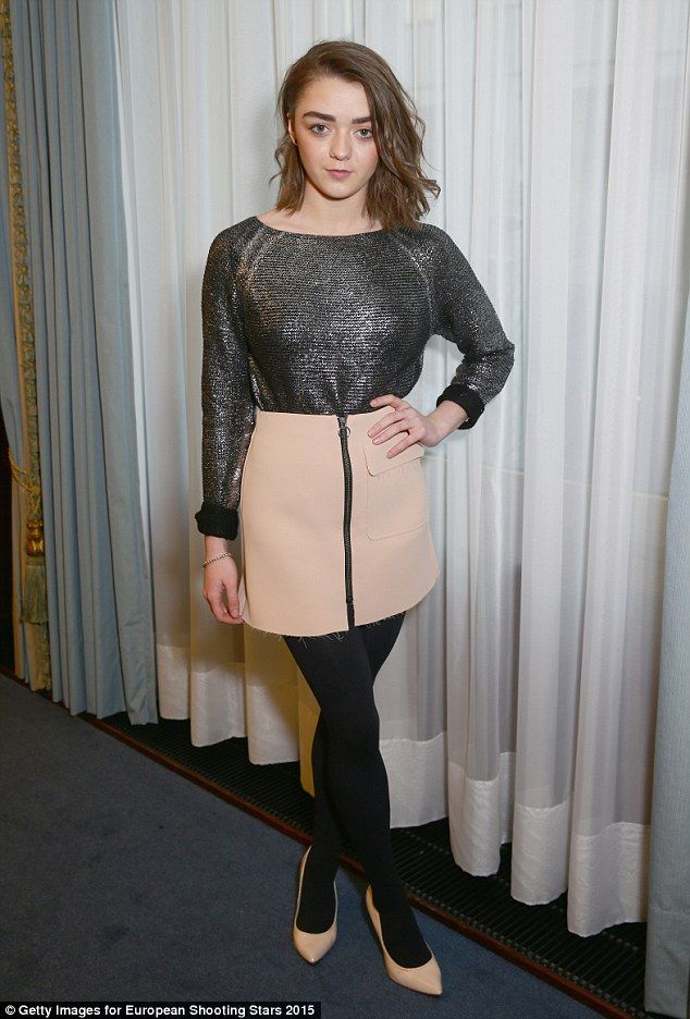Team work: Actress Maisie Williams looked grown up in her cream mini and metallic jumper