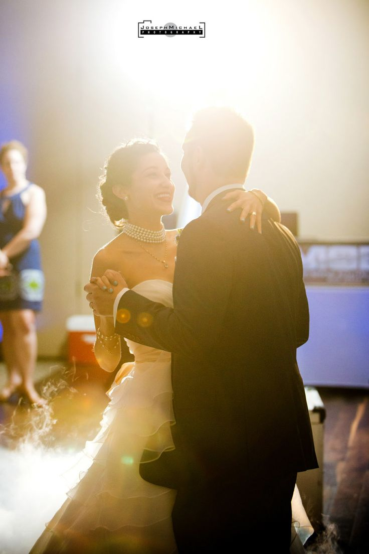 La Primavera Wedding Photography, dancing, bride and groom first dance, happy, lens flare, smoke machine