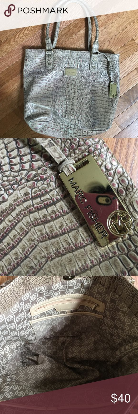 Marc Fisher Handbad Like new Marc Fisher Handbag.  Carried twice.Excellent condition, great neutral color This bag has a great sheen to it with hints of gold. Marc Fisher Bags Shoulder Bags
