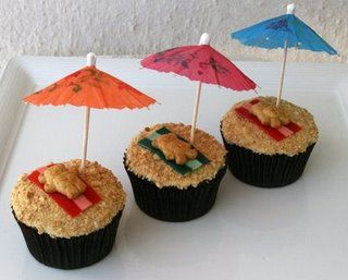 graham cracker crumbs, fruit strips towels, teddy grahams, drink umbrella--teddy tan cupcakes!