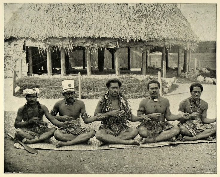 This is an original 1894 halftone print showing a group of singing Fijians at the South Sea Islanders Exhibit. The native residence in the background is a common architectural style among the people. The structure is made primarily of bamboo poles and thatched with cocoa matting, which also adorn the earthen floors.